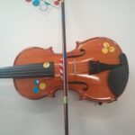 Escena de clase de violín